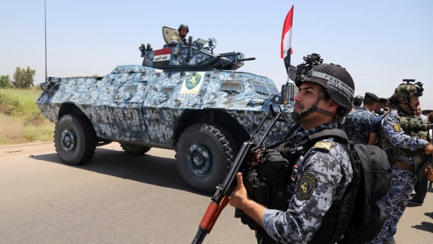 Iraqi troops backed by helicopter gunships launched an operation early Saturday aimed at dislodging Sunni militants from the northern city of Tikrit.