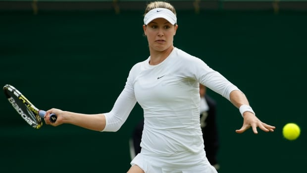 Eugenie Bouchard of Canada plays a return to Andrea Petkovic of Germany during their women's singles match at All England Club on Saturday.