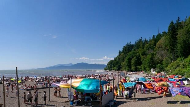 """During the beach season, Wreck Beach can draw up to 14,000 visitors every day, many of whom choose to go """"au naturel"""" to enjoy the elements."""