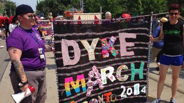 A huge crowd gathered to rally then walk together in the annual Dyke March Saturday afternoon as part of WorldPride.