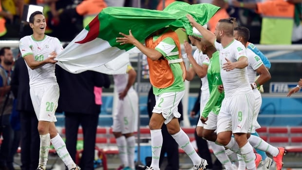 Members of Algeria's World Cup team celebrate advancing to the knockout stage. Many of them are facing a tough decision about whether or not to fast for Ramadan.