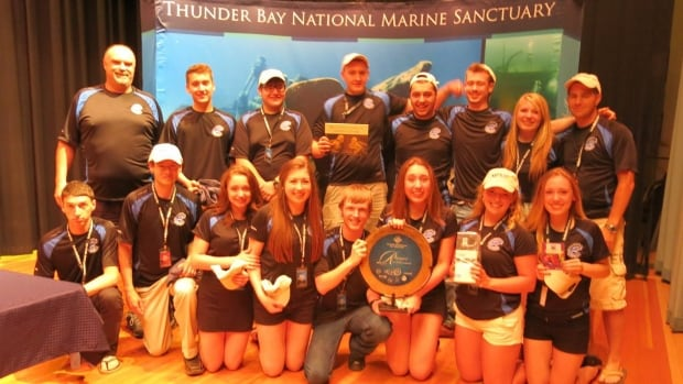 The student team from Clarenville High School of Clarenville, N.L.,  pose for a photo after winning the overall first place in the Ranger (intermediate) class of the Marine Advanced Technology Education (MATE) Center's International Student ROV Competition in Alpena, Mich., on Saturday.