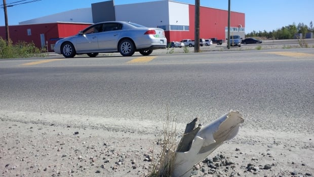 Yellowknife lawyer Garth Wallbridge worries sharp metal like this broken traffic post could cause injuries.
