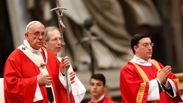 Pope Francis, left, celebrates a mass where he bestowed the Pallium, a woolen shawl symbolizing their bond to the pope, to 24 new Metropolitan Archbishops, in St. Peter's Basilica at the Vatican on Sunday, June 29, 2014.