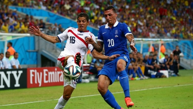 Cristian Gamboa of Costa Rica, left, and Jose Cholevas of Greece compete for the ball during the teams' FIFA World Cup Round of 16 match.