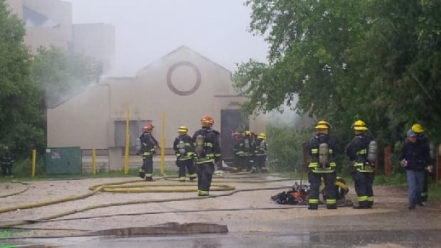Fire crews at the scene of a fire at this building on Tache Avenue near Dumoulin Street on Sunday afternoon.