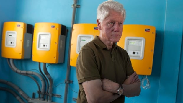 Former U.S. President and UN special envoy to Haiti Bill Clinton visits a Port-au-Prince school. Clinton and Canadian philanthropist Frank Giustra announced a initiative today aimed at helping peanut farmers in the country.