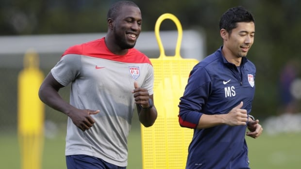 United States' Jozy Altidore, left, works out with trainer Masa Sakihana during a training session in Sao Paulo, Brazil on Saturday.