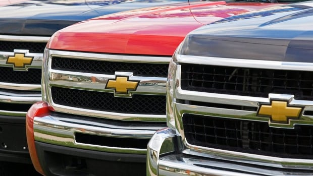 Pickup trucks sit at a GM dealer. General Motors Financial Co Inc said it was served with a subpoena from the U.S. Department of Justice directing it to turn over documents related to underwriting criteria for its subprime auto loans.