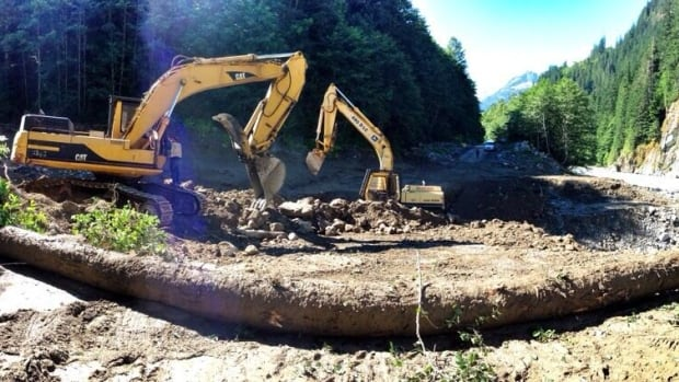 Crews working to clear and repair the washed-out road Monday managed to have it reopened by 1 p.m.