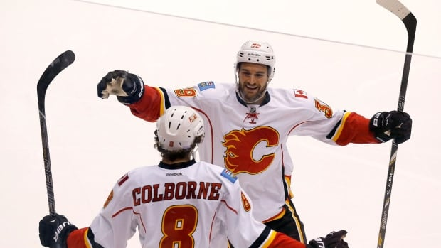 Calgary Flames forward Joe Colborne, bottom, received a qualifying offer, but T.J. Galiardi was not so lucky.