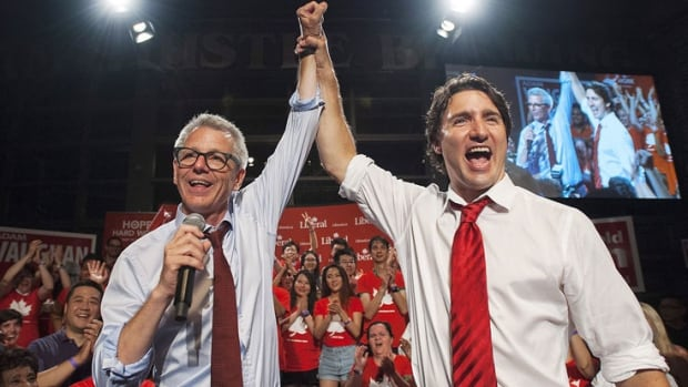 Liberal Adam Vaughan celebrates his byelection win in the Trinity-Spadina riding with party leader Justin Trudeau at the Steam Whistle Brewery in Toronto on Monday.