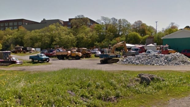 The owner of a property near the Fallsview Park entrance says he has started removing junk cars, trucks and equipment.
