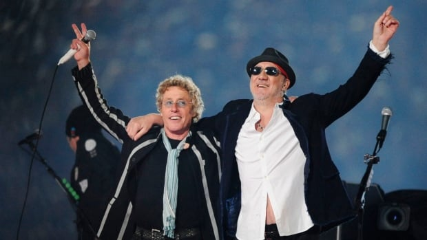 Roger Daltrey, left, and Pete Townshend acknowledge the crowd after performing during the second half of the NFL Super Bowl XLIV football game in Miami on Feb. 7, 2010. Townshend and Daltrey are taking the band on the road for a series of shows in the U.K. celebrating its 50th anniversary and Daltrey suggested it would be their 'long goodbye.'
