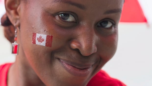 A newly released government study suggests newcomers to the country have misgivings about Ottawa's intention to ensure would-be immigrants possess skills that are in demand in Canada. A woman is seen here enjoying the Canada Day festivities in Montreal, Tuesday, July 1, 2014.
