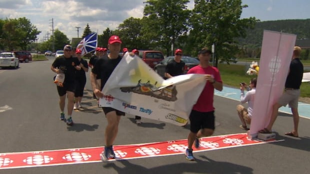 Sailors with HMCS St. John's completed their Run The Rock campaign outside CBC's production centre on Tuesday.