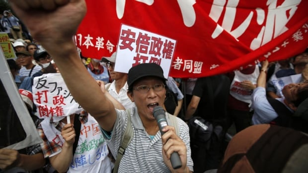 Protesters shouts slogans during a rally against Japan's Prime Minister Shinzo Abe's push to expand Japan's military role.