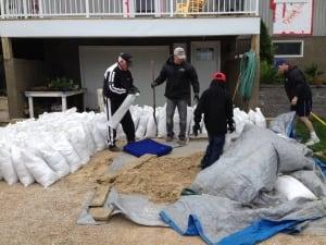 Harry Frederick prepare sandbags