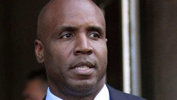 In this 2011 file photo, former baseball player Barry Bonds leaves federal court during his perjury trial in San Francisco. Bonds lost his appeal of his felony obstruction of justice conviction, but an appeals court has now said it will reconsider the conviction.