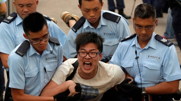 Police arrested 511 people who staged an unauthorized overnight sit-in on an avenue running through the heart of Hong Kong.