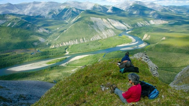 Relaxing in the alpine terrain above the Hart River.