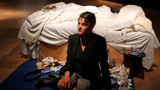 British artist Tracey Emin poses next to her 1998 artwork My Bed in London in June.
