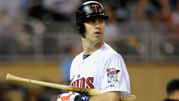 Twins first baseman Joe Mauer hurt himself during Tuesday night's game against Kansas City and has been placed on the 15-day disabled list with a strained oblique (rib cage) muscle. He was hitting .320 in his previous 19 games.