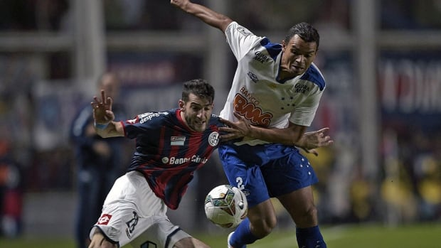 Argentina's San Lorenzo's midfielder Ignacio Piatti, left, has agreed to terms with the Montreal Impact to join the MLS club as its second designated player in August. He replaces  midfielder Hernan Bernardello, who left this week to join Cruz Azul in Mexico.