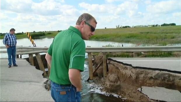 On the ground in the Melville area, Premier Brad Wall gets a close up view of the damage to Saskatchewan's highway infrastructure.
