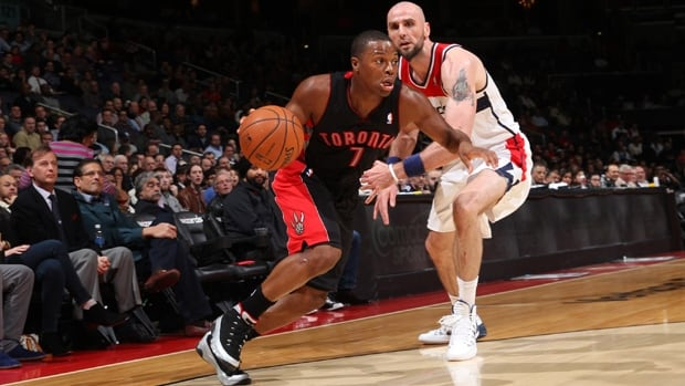 Kyle Lowry (7) of the Raptors dribbles by Marcin Gortat in a 103-93 victory over the Wizards at the Verizon Center on Feb. 18.