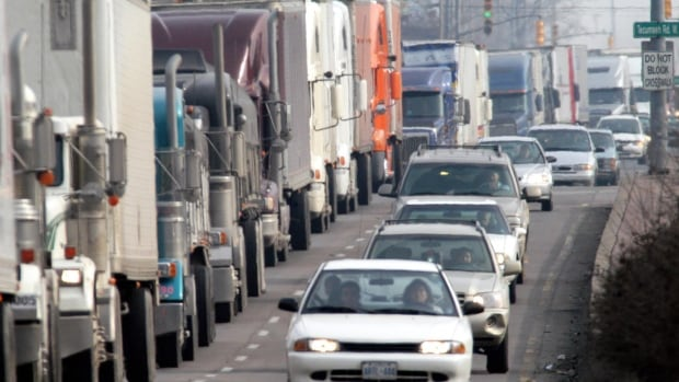 Transport trucks line up at the border in Windsor, Ont. Trade between Canada and the U.S. expanded in May.