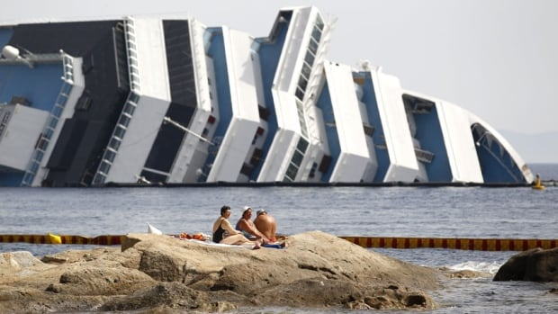Vacationers bask in front of the wreckage of capsized cruise liner Costa Concordia in June 2012. The wrecked cruise liner should be refloated within about 10 days, according to officials.