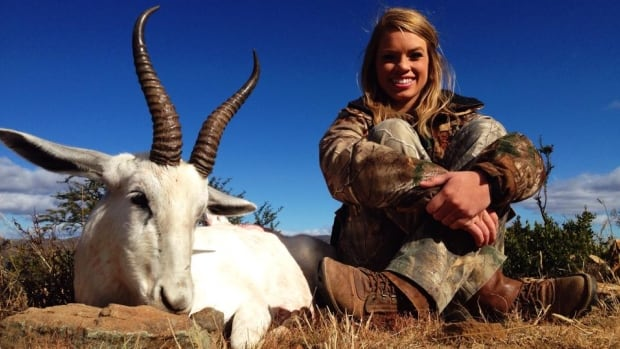 Kendall Jones poses alongside a white springbok she killed while on a hunting trip in Africa. Facebook has pulled several images of Jones posing with dead animals, saying the images violated the site's policy regarding animal images.