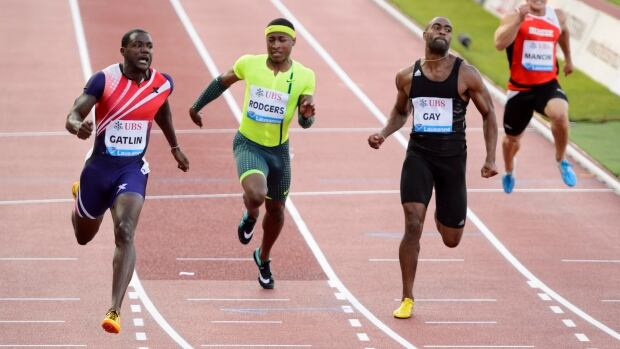 Justin Gatlin, left, crosses next to Michael Rodgers, 2nd left, Tyson Gay, 2nd right, and Pascal Mancini, right, in the men's 100 metres in Lausanne on Thursday.