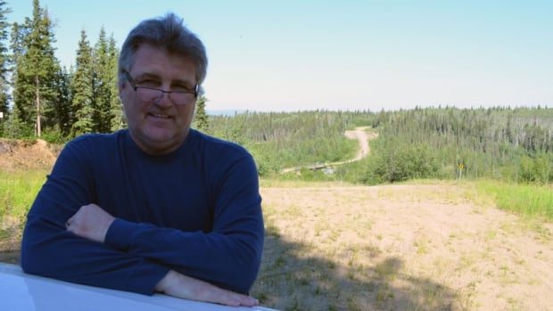 Mark Macneill, band manager for the Pehdzeh Ki First Nation in Wrigley, stands in front of the winter road leading north to the Sahtu communities. He is looking for ways the band can take advantage of construction of the all-season Mackenzie Valley Highway.