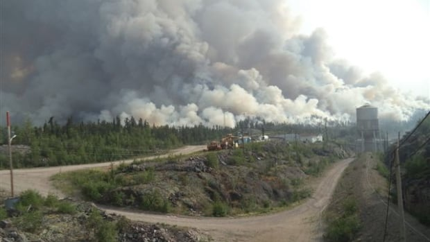 Fire crews tackle a forest fire near the Taltson hydroelectric dam near Fort Smith, N.W.T. The fire came close to transmission lines, forcing several communities south of Great Slave Lake to turn to backup diesel-powered generators. It's one of the worst forest fire seasons in the territory in 20 years.