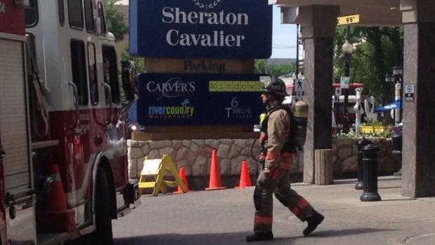 A Saskatoon firefighter outside of the Sheraton Cavalier Hotel.