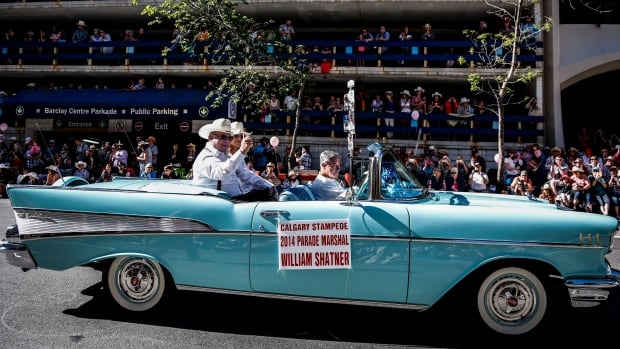 Parade marshal William Shatner waves to the crowd during the Calgary Stampede parade on Friday.