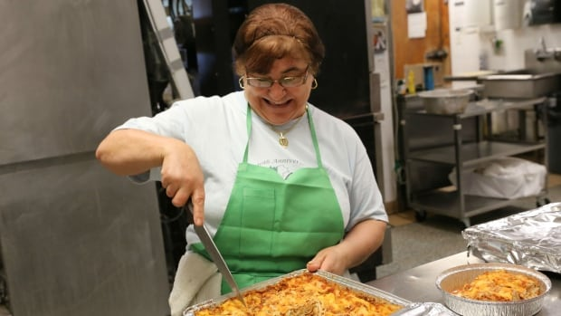 An employee at the Caruso Club in Sudbury helps prepare lasagne for the annual Italian Festival. The event features entertainment, and of course, food.
