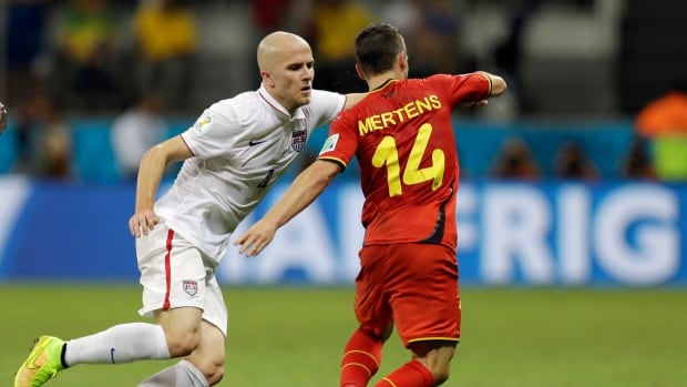 Michael Bradley, left, is shown on July 1 competing for the U.S. with Belgium's Dries Mertens during the World Cup round of 16.