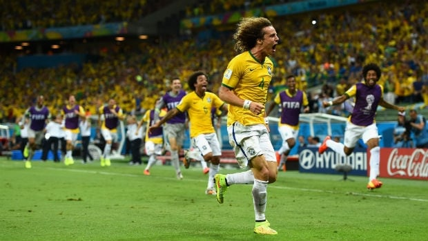 David Luiz of Brazil celebrates his free kick goal against Colombia during the teams' quarter-final matchup at the 2014 FIFA World Cup.