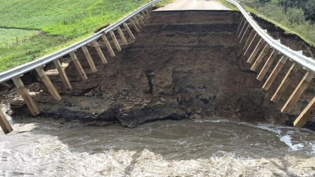 Pearl Creek washes out highway near Killaly, sending more water to Crooked Lake.