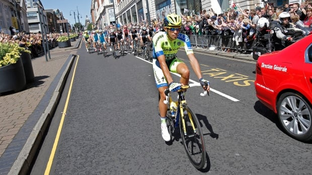 Spain's Alberto Contador rides ahead of the pack during the ceremonial procession ahead of the start of the first stage of the Tour de France cycling race.