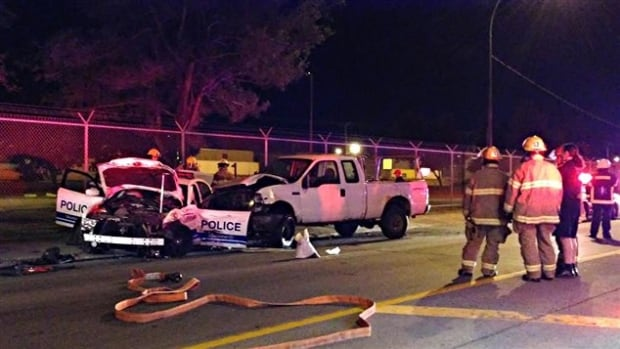 Police say the truck driver had been drinking and veered into the path of an oncoming police cruiser occupied by two officers and two 13-year-old passengers.