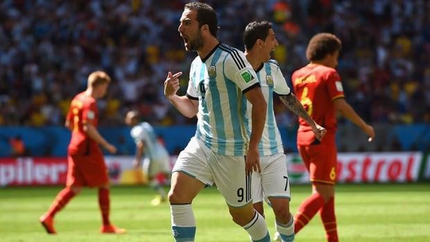 Gonzalo Higuain of Argentina celebrates his goal in the eighth minute against Belgium on Saturday.