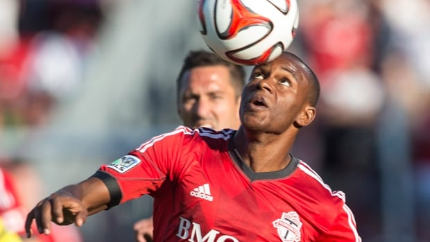 Jackson Goncalves of Toronto FC uses his head to control the ball with Davy Arnaud in pursuit in Saturday's 2-1 loss to DCU.
