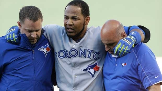 Edwin Encarnacion is helped off early in Saturday night's game in Oakland.