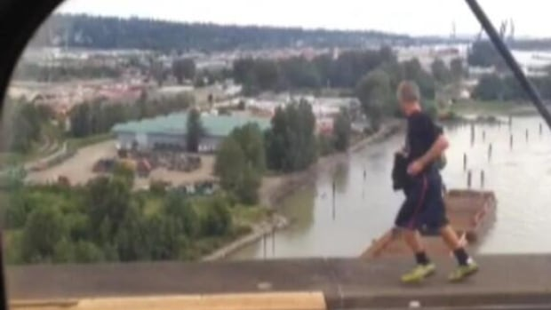 Twitter user @theREALpreet shared this photo of a man running on the SkyTrain SkyBridge between New Westminster and Surrey, B.C., at 7 p.m. PT Saturday.