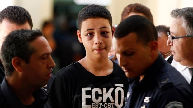 The United States called for speedy investigation of an incident in which 15-year-old Tariq Khdeir, centre, was badly beaten during his detention by Israeli paramilitary police.