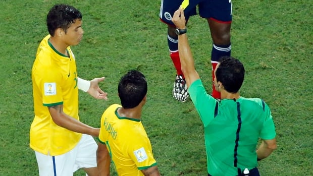 Brazil's Thiago Silva gets a yellow card during the World Cup quarter-final soccer match between Brazil and Colombia at the Arena Castelao in Fortaleza, Brazil.